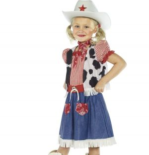 A little girl wearing a cowgirl sweetie costume